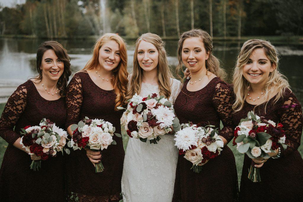 Rustic, country, burgundy, white, burlap, beige, roses, dahlias, spray roses, bridesmaids.