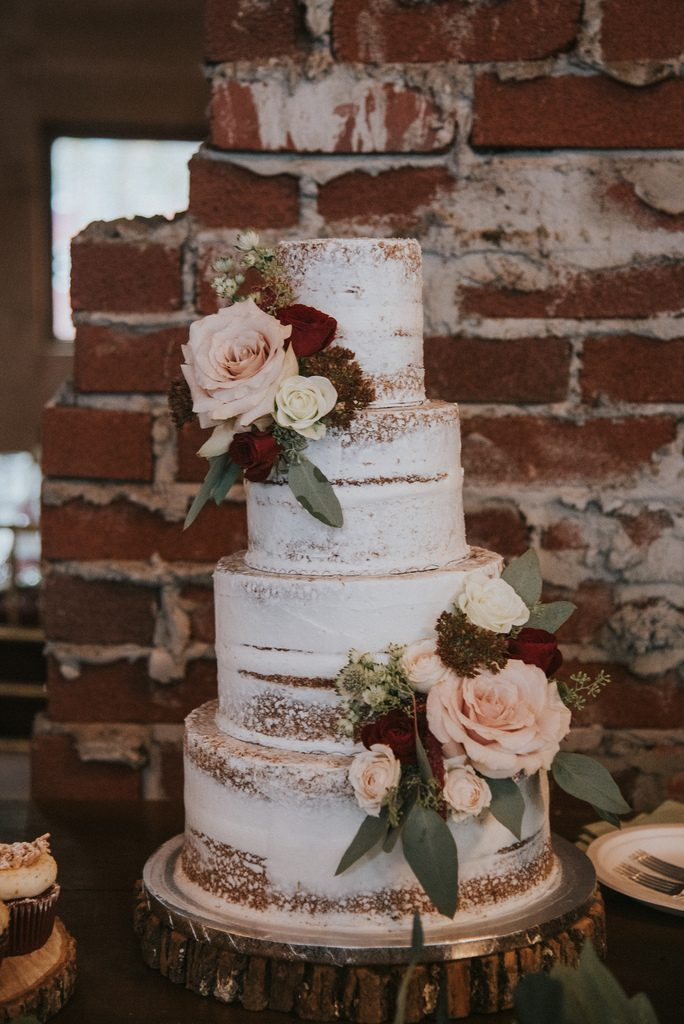 Rustic, country, burgundy, white, burlap, beige, roses, dahlias, spray roses, cake.