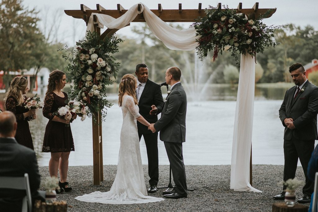Rustic, country, burgundy, white, burlap, beige, roses, dahlias, spray roses, ceremony.