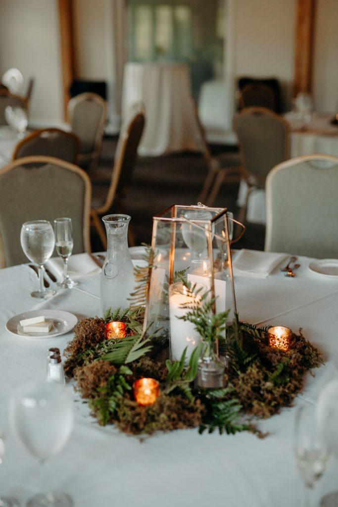 Summer wedding, fun, party of the summer, greens, ferns, forest greens, rose gold, copper, cream, lanterns, moss, centerpiece.